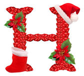 Christmas letter H with Santa Claus cap. — Stock Photo
