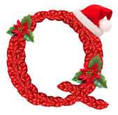 Christmas letter Q with Santa Claus cap. — Stock Photo