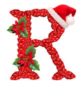 Christmas letter R with Santa Claus cap. — Stock Photo