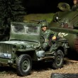 Stock Photo: WWII scene Us soldier with car