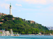 Port of Trieste with Faro della Vittoria, or Victory Lighthouse. — Stock Photo