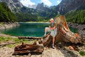 Traveler against Dachstein peak — Stock Photo