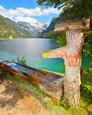 Fountain with drinking water over mountain lake — Stock Photo