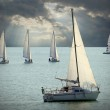 Постер, плакат: The Sailboats on a sea against a dramatic sky Retro style picture