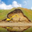 An excavator in old mine. Damaged landscape before recultivation. — Stock Photo