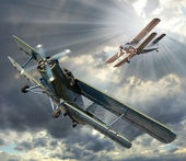Biplanes in cloudy sky — Stock Photo