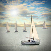 The Sailboats on a sea against a dramatic sky. Retro style picture. — Stockfoto