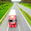 Motion blurred trucks on highway. Transportation industry concept. — Stock Photo