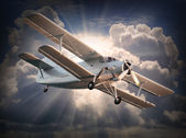 Retro style picture of the biplane. — Stock Photo