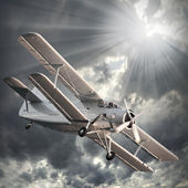 Retro style picture of the biplane. — Stock Photo