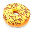 Vanilla glazed donut with cocoa sprinkles — Stock Photo