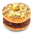 Two glazed donut with cocoa and vanilla sprinkles — Stock Photo