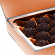 Chocolate candies in a paper box. — Stock Photo