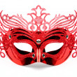 Decorated mask for masquerade on red velvet. — Stock Photo