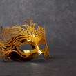Decorated mask for masquerade on dark background — Stock Photo #33799127