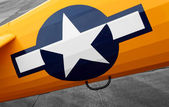 Insignia white star on biplane — Stock Photo
