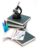Microscope, books and others tools for for university education. — Foto de Stock