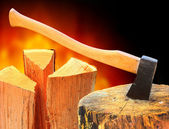 Cut log fire wood and axe — Stock Photo