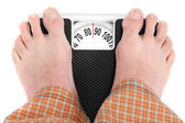 Man standing on weighing machine — Stock Photo