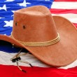 Stock Photo: Brown leather hat on americflag