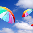 Three rainbow umbrellas — Stock Photo #33808209