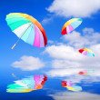 Three rainbow umbrellas  — Stock Photo