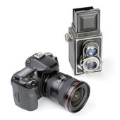 Modern dslr camera and vintage medium format two-lens camera — Stock Photo