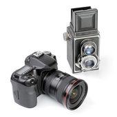 Modern dslr camera and vintage medium format two-lens camera — Stock Photo
