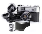Vintage camera with a 35mm film — Stock Photo