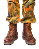 Soldier legs in old army paratroopers combat boots — Stock Photo