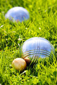Bocce balls on a green grass. Close up with shallow dof. — Stock Photo