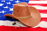 Brown leather hat on american flag — Stock Photo