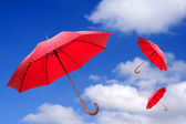 Three red umbrellas — Stock Photo