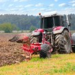 Tractor plowing the field — Stock Photo #34675609