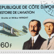 A stamp printed in The Ivory Coast shows The Wright brothers  — Stock Photo
