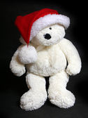Teddy bear with christmas hat — Stok fotoğraf