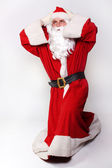 Santa holding his head — Stock Photo