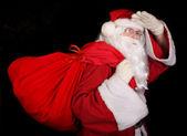 Santa with bag looking — Zdjęcie stockowe