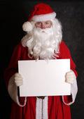 Santa showing paper — Stock Photo