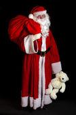 Babbo Natale con un giocattolo — Foto Stock