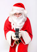 Santa holding retro camera — Foto Stock