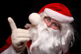 Santa showing forefinger — Stock Photo