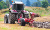 Tractor plowing the field — 图库照片
