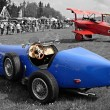 Stock Photo: Historic racer and historic triplane Fokker DR 1