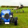 Stock Photo: Historic racer and historic monoplane