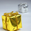 Closed golden and silver box for gift — Stock Photo