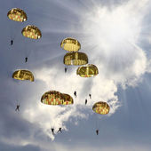 The skydivers on stormy sky. — Stock Photo