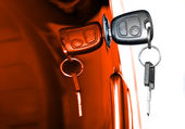 Key at orange car doors — Stockfoto