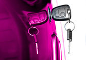 Key at violet car doors — Stock Photo
