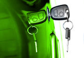 Key at green car doors — Stock Photo